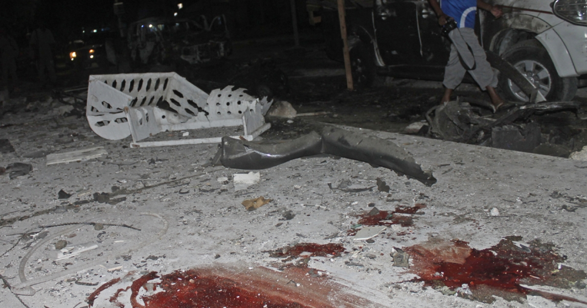 A picture shows the site of a car bomb attack outside the Maka al Mukarama hotel in Mogadishu, Somalia, on Nov. 8, 2013. Around 11 people were killed in the attack at the gate of the hotel, which was hosting several VIPs at the time of the blast.</p>