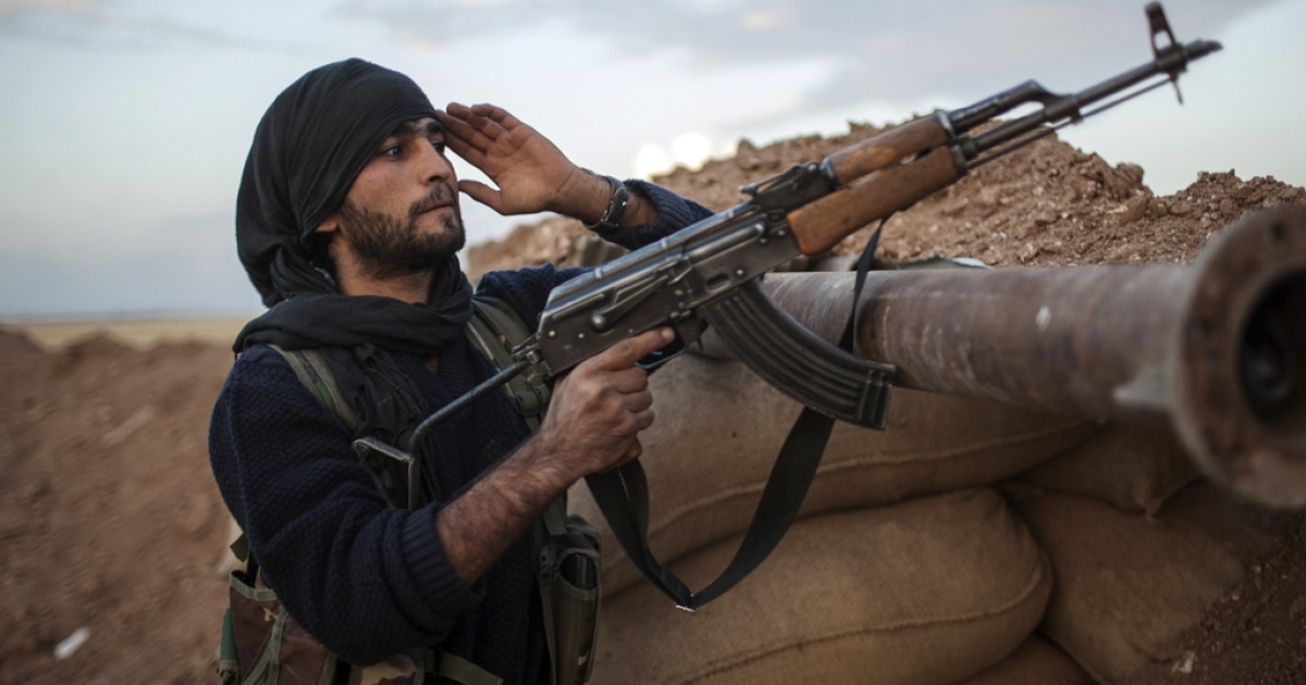 A fighter of the Kurdish of the Committees for the Protection of the Kurdish People (YPG) holds a position in a trench in the Kurdish town of Derik (aka al-Malikiyah in Arabic), in the northeastern Hasakeh governorate on the border with Turkey and Iraq. Kurdish fighters from several villages in oil-rich Hasake province are engaged in combat against Al-Qaeda affiliated groups the Islamic State of Iraq and the Levant (ISIL) and Al-Nusra Front, said the Syrian Observatory for Human Rights.</p>