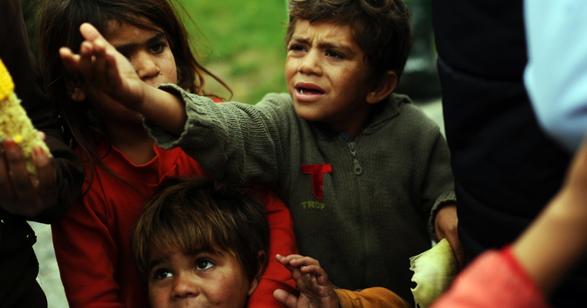 Syrian children wait for food in a park where they live with their families on November 3, 2013, in Istanbul.</p>