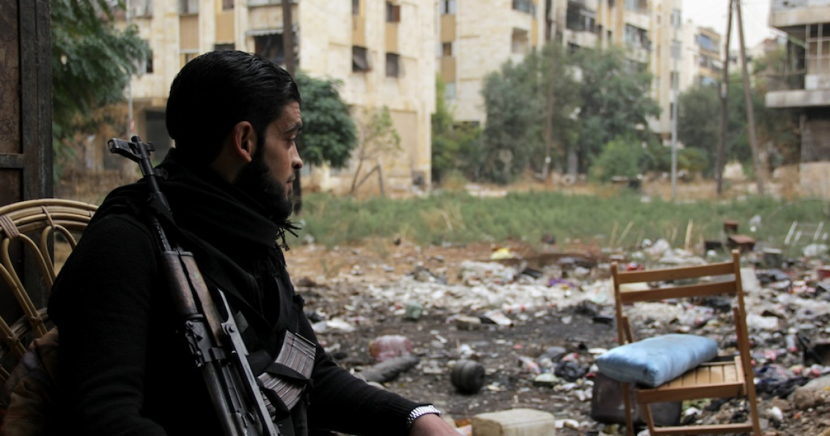 A rebel fighter pictured in the northern city of Aleppo on Nov. 7, 2013. International inspectors confirmed Thursday that a chemical weapons facility in the city had been 'long abandoned.'</p>