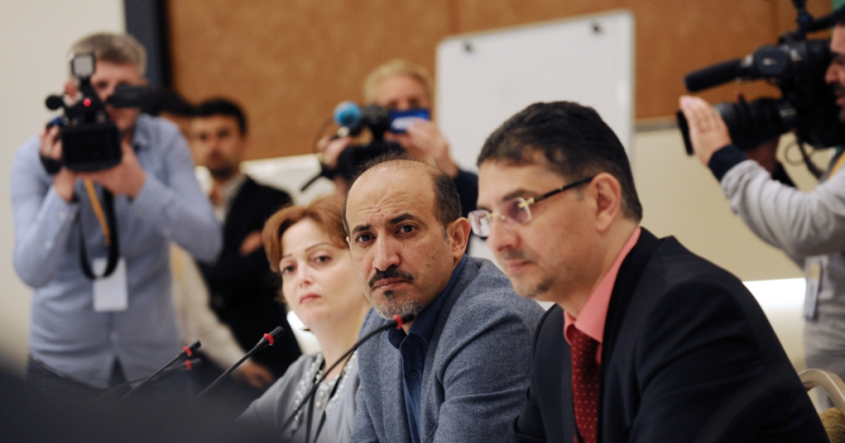 President of the Syrian National Coalition (SNC) Ahmad Jarba (C) and members attend a meeting of the National Coalition on November 9, 2013, in Istanbul. Syria's fractured opposition meets for key talks to decide whether or not to attend a peace conference that western powers want to hold in Geneva.</p>