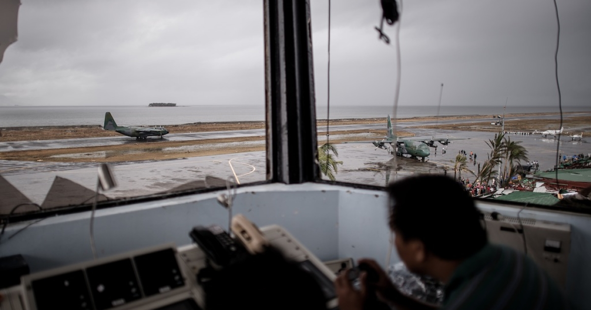 A Filipino civil aviation personnel mans the damaged control tower of the airport as C-130 aircrafts take part in evacuation operations in Tacloban, on November 12, 2013 after Super Typhoon Haiyan swept over the Philippines. The typhoon that destroyed entire towns across the Philippines is believed to have killed more than 10,000 people, which would make it the country's deadliest recorded natural disaster.</p>