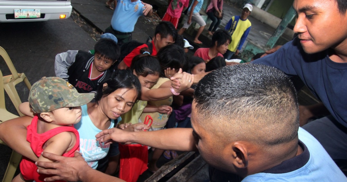 Residents of Legazpi city in Albay province, south of Manila, are evacuated on November 7, 2013 ahead of a super typhoon that was strengthening in the Pacific Ocean. Authorities warned Typhoon Haiyan, with wind gusts exceeding 330 kilometres (200 miles) an hour, could cause major damage across a vast area of the central and southern Philippines when it makes landfall on November 8.</p>