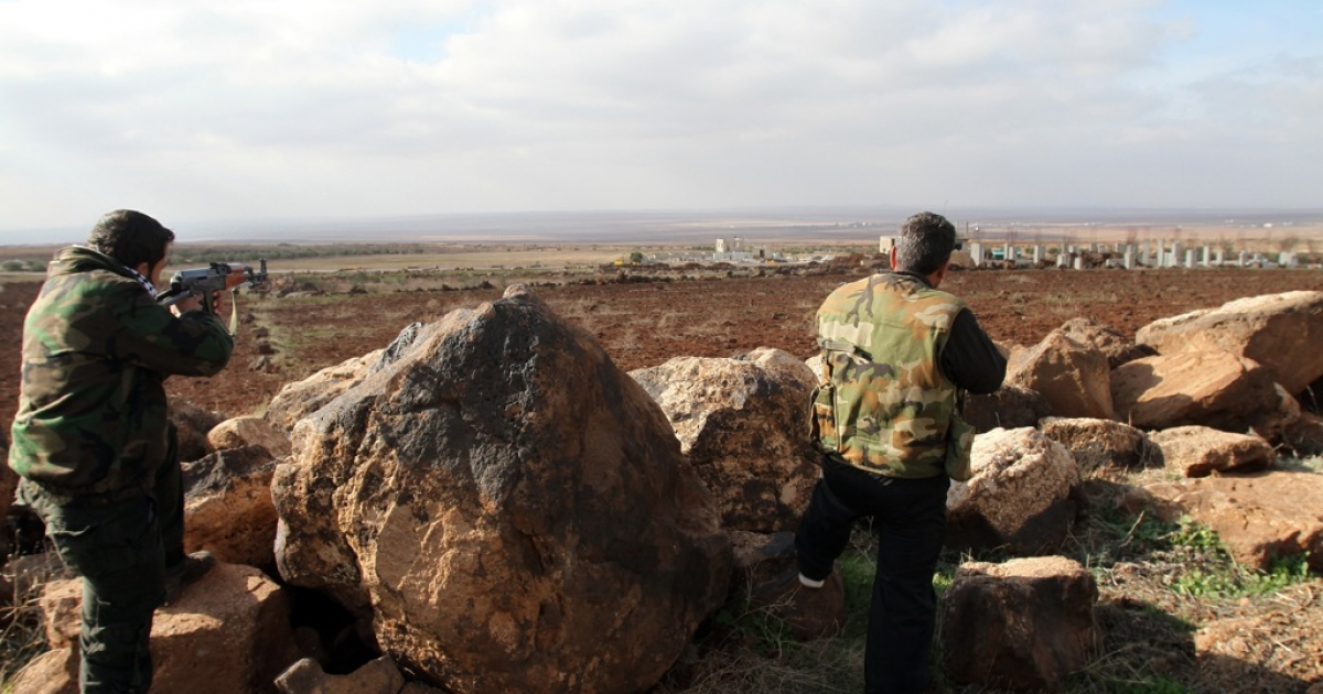 Syrian soldiers point their rifles towards the rebel-held province of Daraa from their position in the southern city of Sweida on January 23, 2013.</p>