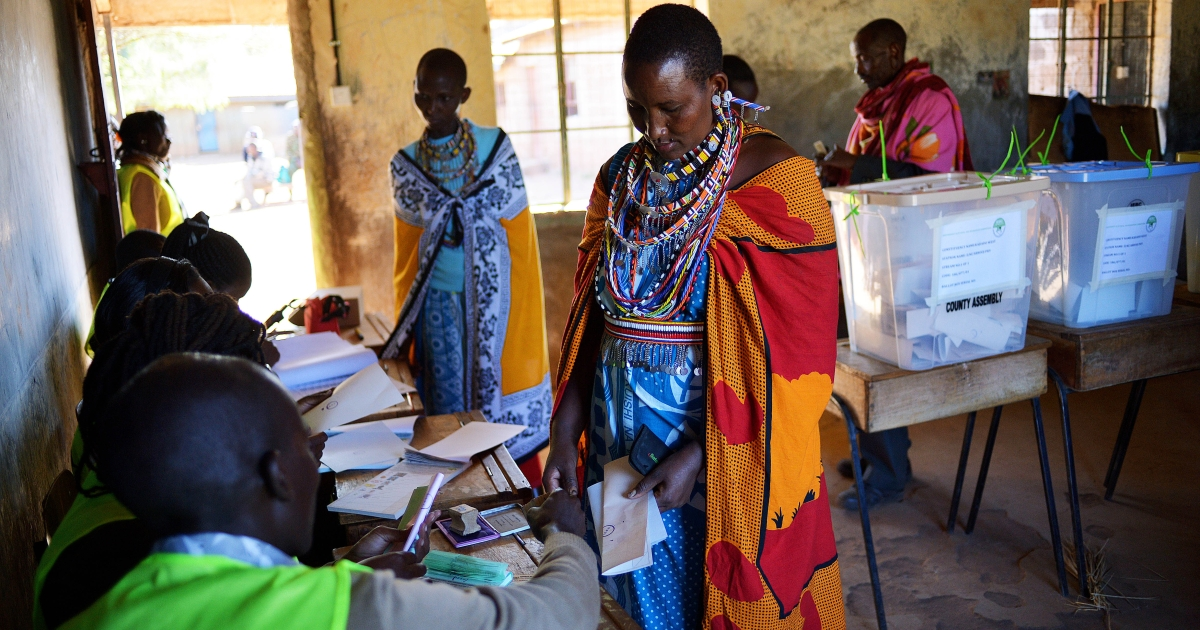 A Maasai woman collects her papers before voting in Ilngarooj, Kajiado County, Maasailand, on March 4, 2013 during the first nationwide elections since the violence-wracked polls five years ago.</p>