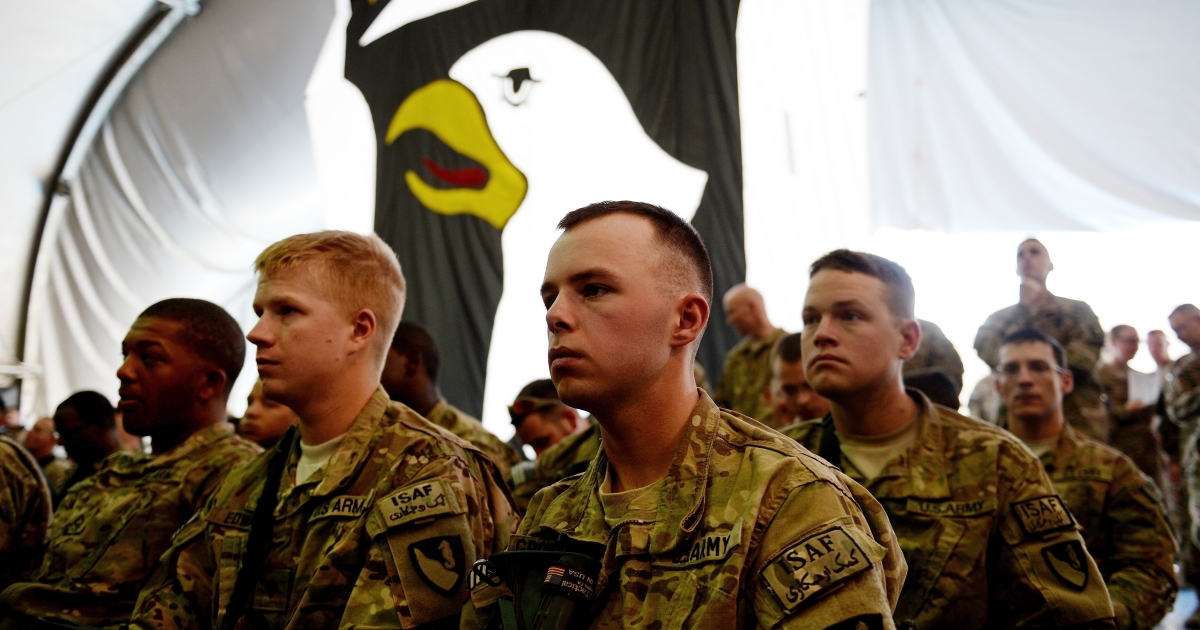 US soldiers attend a naturalization ceremony at the US base in Bagram, north of Kabul, on July 4, 2013.</p>