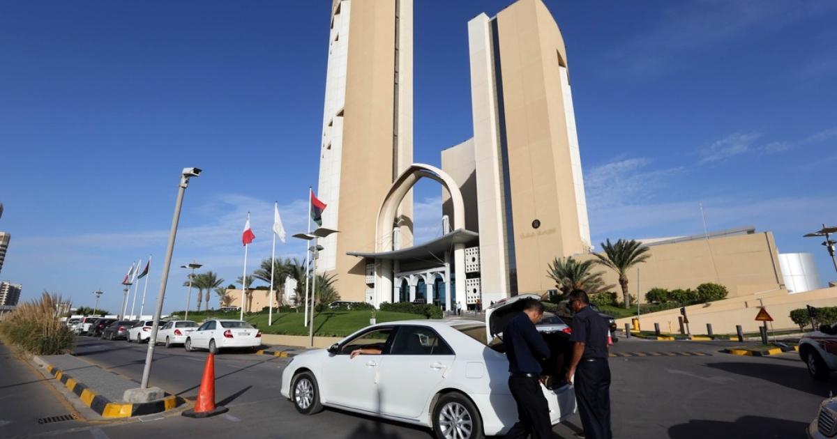 Security guards search vehicles outside the Corinthia Hotel in the Libyan capital, Tripoli, where Prime Minister Ali Zeidan was seized at dawn by armed men on October 10, 2013.</p>