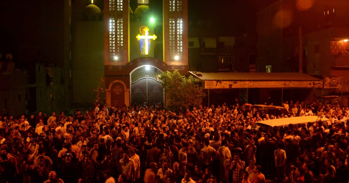 Hundreds of Egyptians gather in front of the Virgin Mary Coptic Christian church in Cairo after gunmen on a motorbike shot dead three people late on October 20, 2013. Another 12 people were wounded in the first such assault targeting Christians in Cairo since the military coup that ousted Islamist president Mohamed Morsi on July 3.</p>