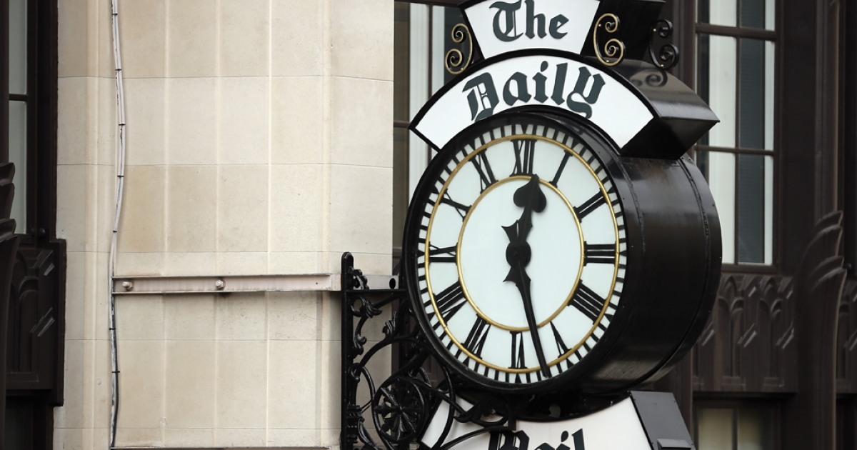 A general view of a clock on the side of Northcliffe House, where the offices of British newspapers the Daily Mail and Mail On Sunday are located, on October 4, 2013 in London, England.</p>