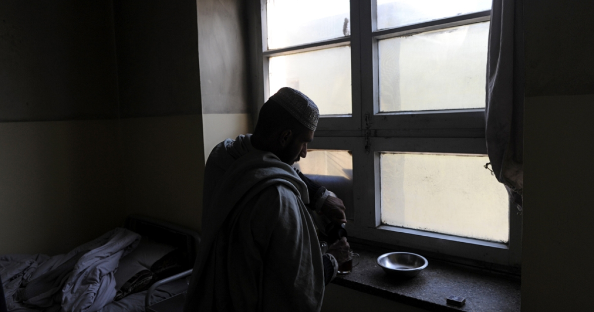 An Afghan man prepares tea near his bed in a psychiatric ward of a local hospital in Kabul. Scarred by decades of war, social problems and poverty, more than 60 percent of Afghans suffer from stress disorders and mental health problems.</p>