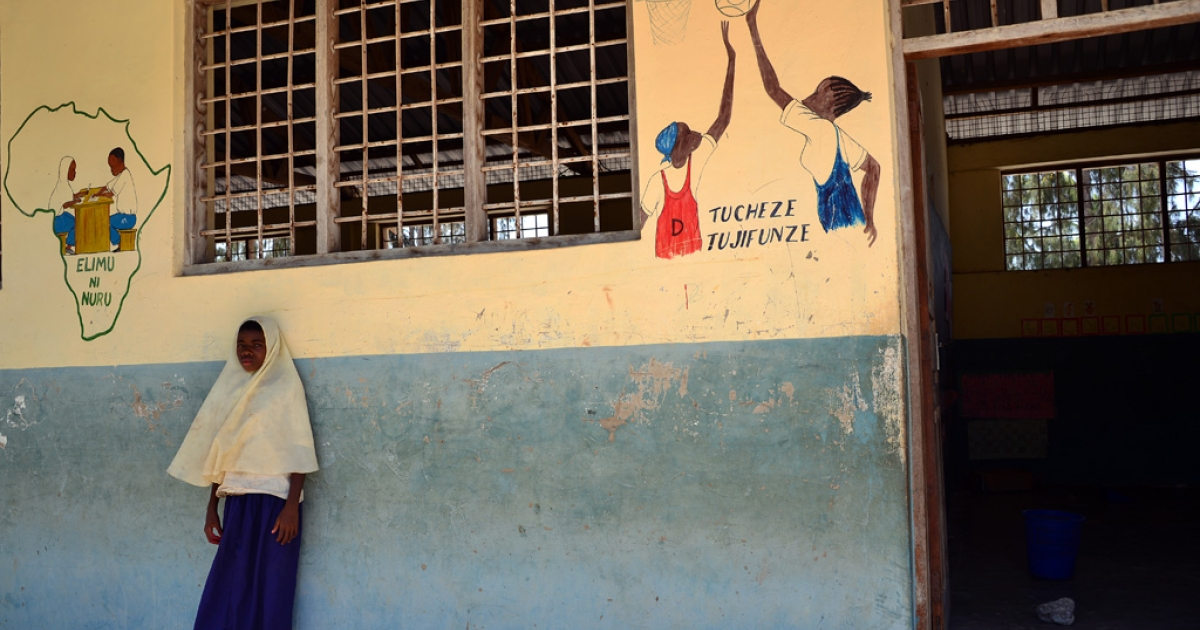 A pupil stands in the courtyard of a school on January 8, 2013 in Zanzibar, Tanzania.</p>