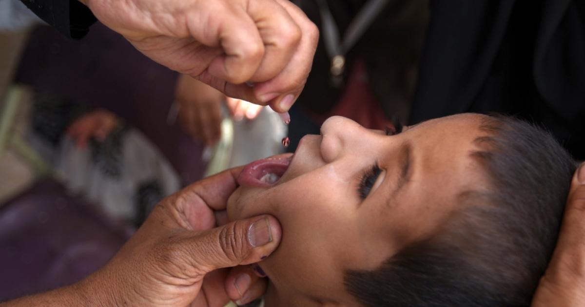 A child receives a polio vaccine in Yemen.</p>