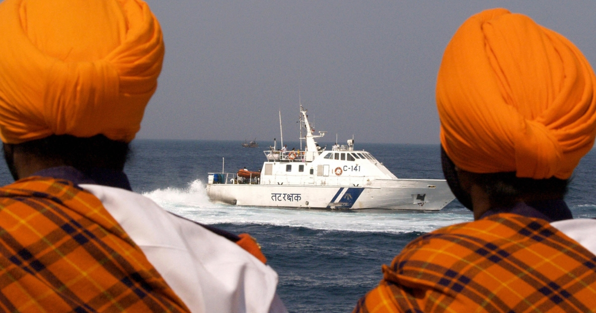 Members of the Sikh Light Infantry watch as the 'Interceptor' craft of the Indian Coast Guard motors off the Porbunder coast in the western state of Gujurat, Feb. 1 2006.</p>