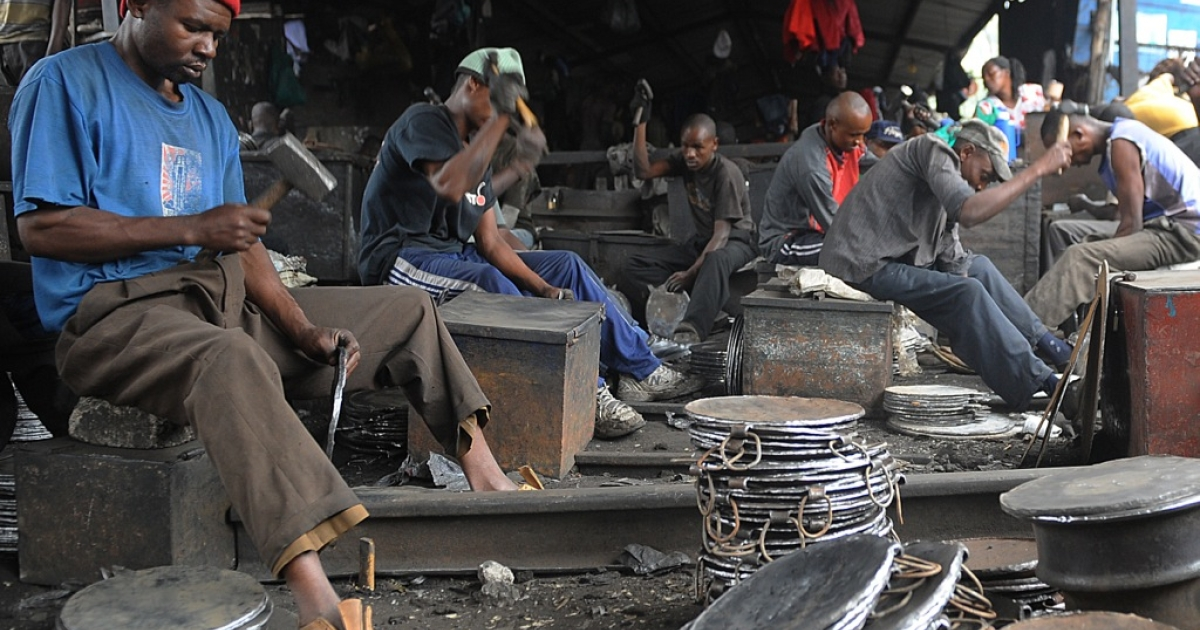 Kenyan blacksmiths make frying pots that sell for $3.5o each at the Kamukunji market in Nairobi on June 20, 2012. The 2013 Afrobarometer survey of 34 countries put into sharp relief the continent's much-vaunted GDP growth rates by looking instead at the daily lives of Africans, who say they are not benefiting from economic growth.</p>