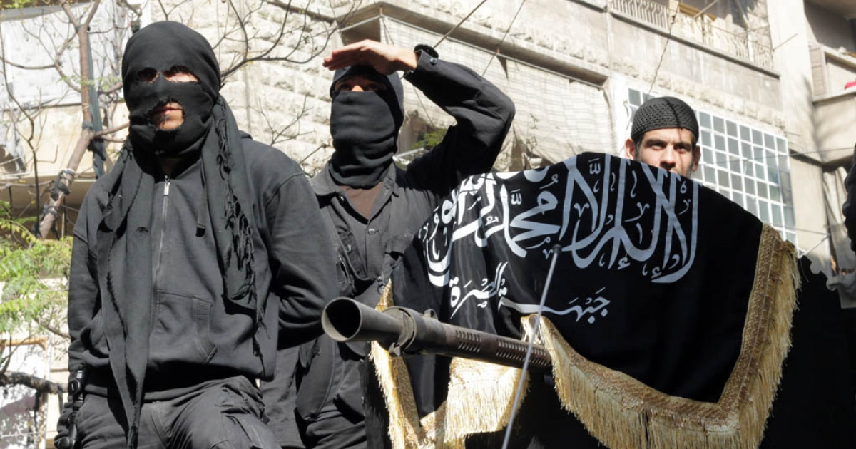 Members of jihadist group Al-Nusra Front take part in a parade calling for the establishment of an Islamic state in Syria, at the Bustan al-Qasr neighbourhood of Aleppo, on October 25, 2013. Syrian state television reported on Oct. 25, 2013 that the Syrian army had killed Nusra's leader, Abu Mohammad al-Golani.</p>