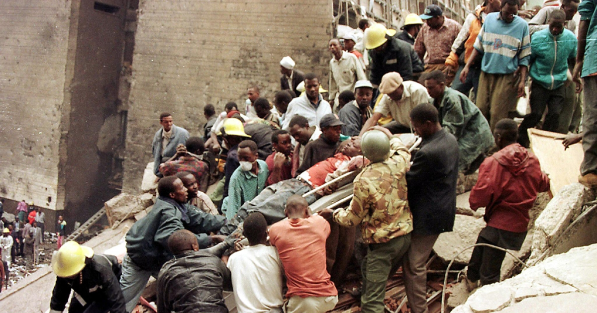 Rescuers work to help survivors amid the devastation brought in by a bomb explosion in Al-Qaeda's first major international attack near the US embassy and a bank in Nairobi on August 7, 1998 that killed at least 60 people, including eight Americans, and left more than 1,000 injured.</p>