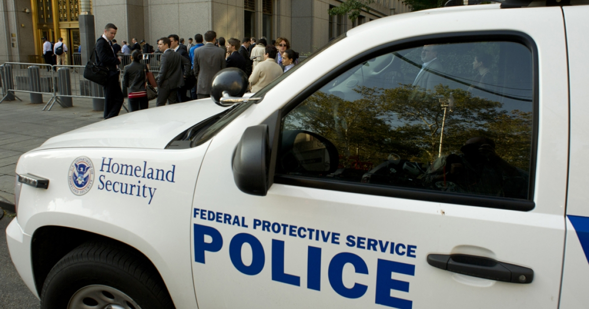 People enter enter the Federal Courthouse past security on October 15, 2013 in New York.</p>