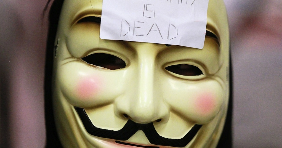 A demonstrator wears a mask on Aug. 15, 2011 in San Francisco, California.</p>
