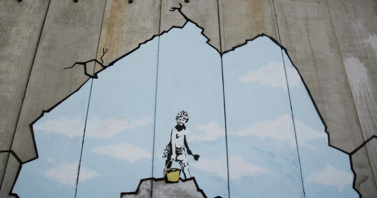 A Banksy piece on Israel's West Bank barrier in Ramallah, Aug. 6, 2005.</p>