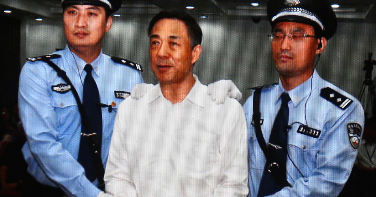 A screen shows the picture of the sentence of Chinese politician Bo Xilai (Center) on September 22, 2013 in Beijing, China. The Jinan Intermediate People's Court announced Bo Xilai, former member of the CPC Central Committee Political Bureau, was sentenced to life imprisonment on Sunday for bribery, embezzlement and abuse of power.</p>