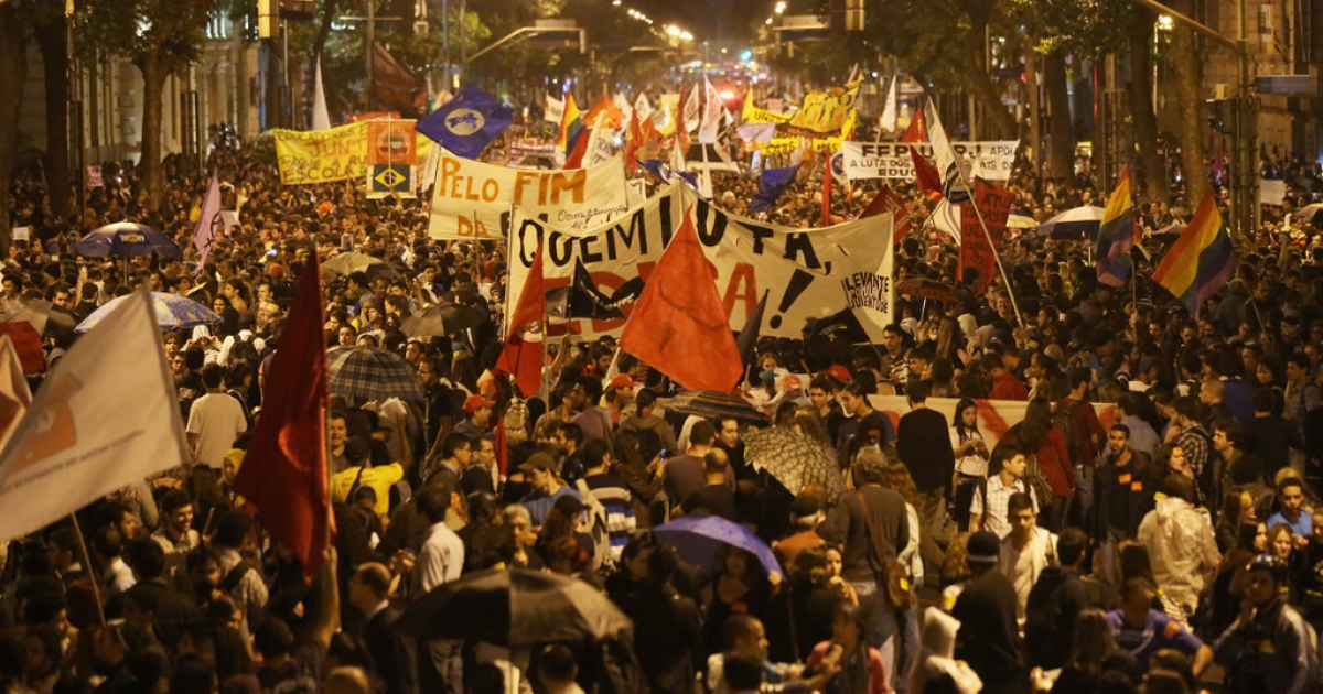 Protesters  stand during a mostly peaceful demonstration by teachers and supporters calling for better public education and services on Oct. 7, 2013 in Rio de Janeiro, Brazil.</p>