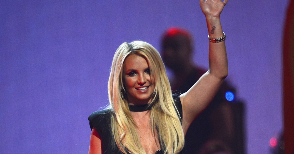 Britney Spears speaks onstage during the iHeartRadio Music Festival at the MGM Grand Garden Arena in Las Vegas on Sept. 21, 2013.</p>