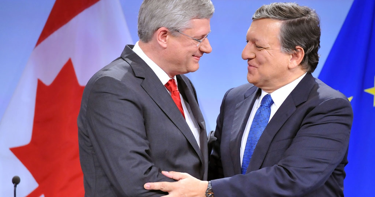 Canadian Prime Minister Stephen Harper, left, and European Commission President Jose Manuel Barroso shake hands after signing a free-trade accord more than four years in the making, on October 18, 2013 at the EU headquarters in Brussels.</p>