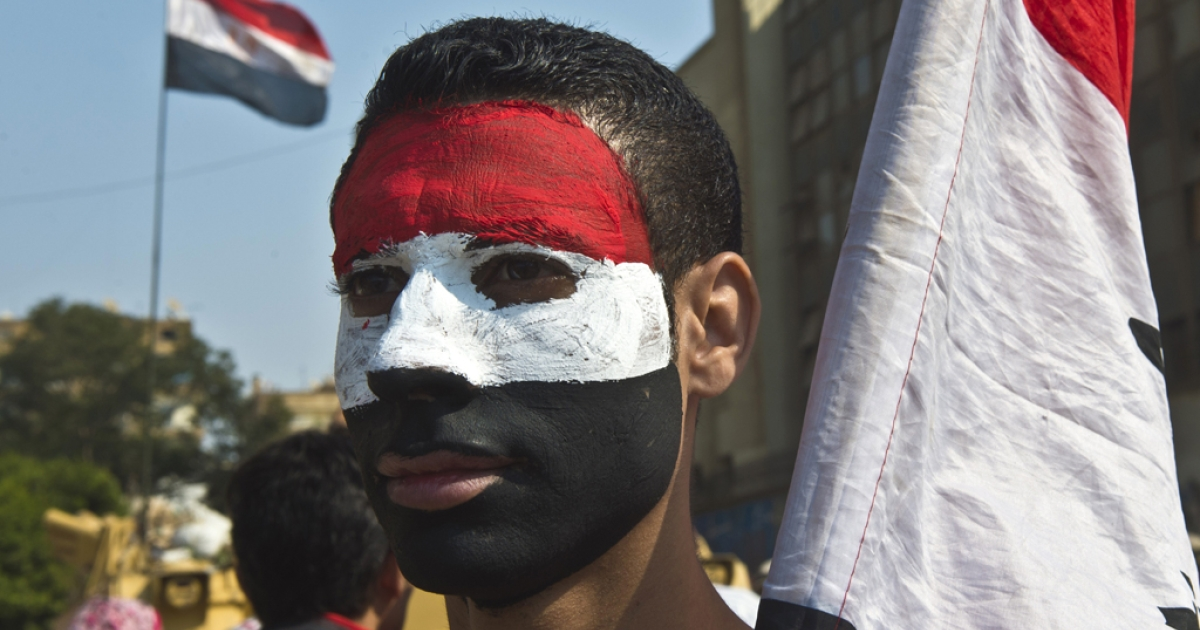 A youth with his face painted the national colors of Egypt as the country marks the 40th anniversary of the 1973 Arab-Israeli war on October 6, 2013.</p>