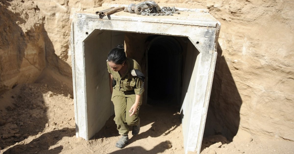 An Israeli soldier exits the entrance of a tunnel allegedly dug by Palestinians beneath the border between the Gaza Strip and Israel and recently uncovered by Israeli troops, on October 13, 2013.</p>