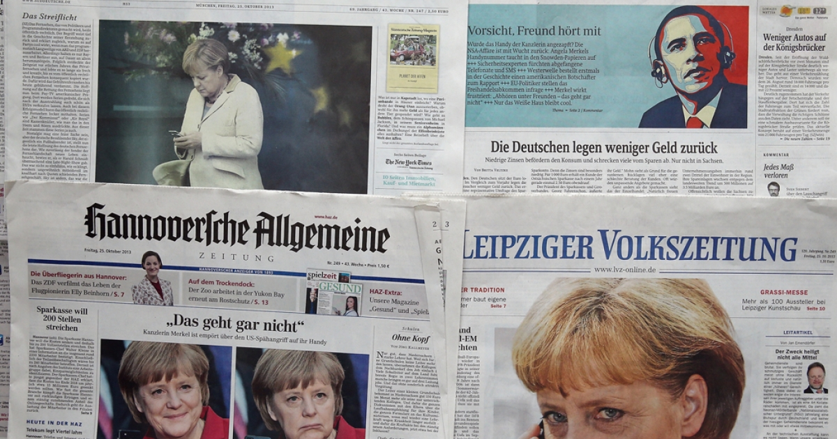 German newspapers with front page photos referring to the NSA eavesdropping of German Chancellor Angela Merkel's phone scandal on October 25, 2013 in Berlin, Germany.</p>