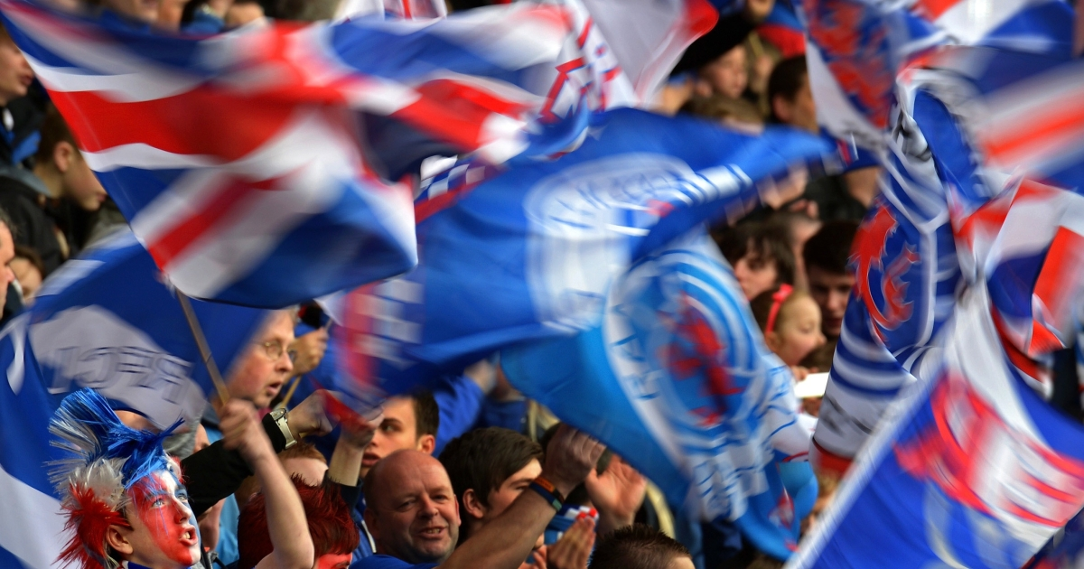 Rangers fans wave the Union Jack. A hard core of supporters are helping perpetuate sectarianism.</p>