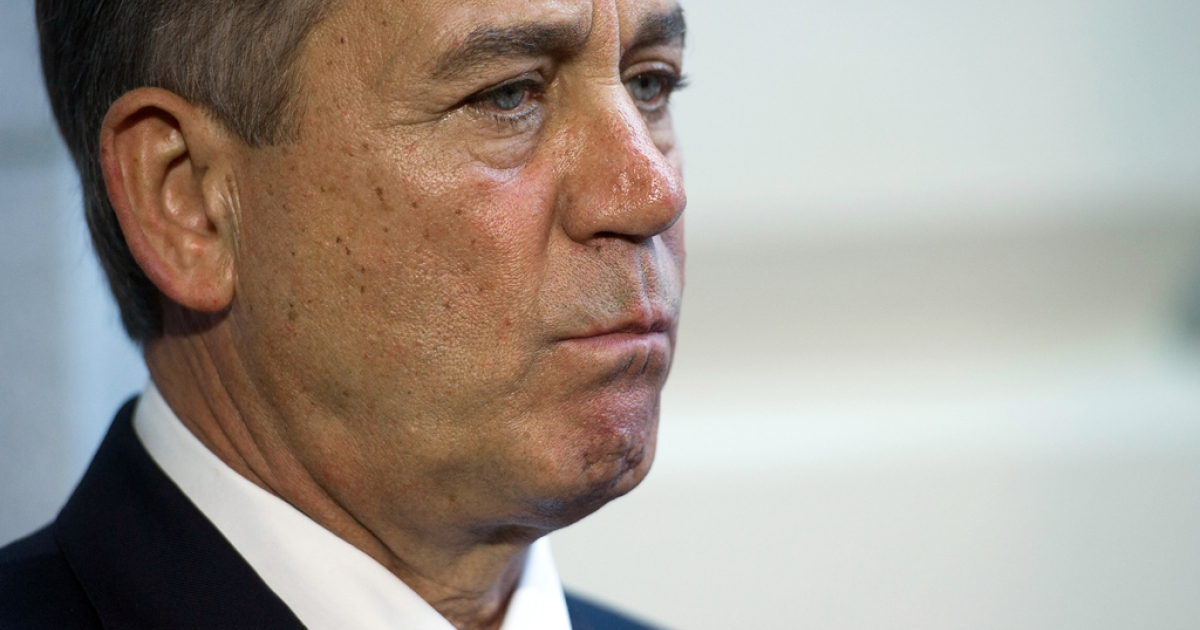 Speaker of the House John Boehner, R-Ohio, listens as House Republican leadership speaks with the press on Capitol Hill in Washington, DC, October 15, 2013.</p>