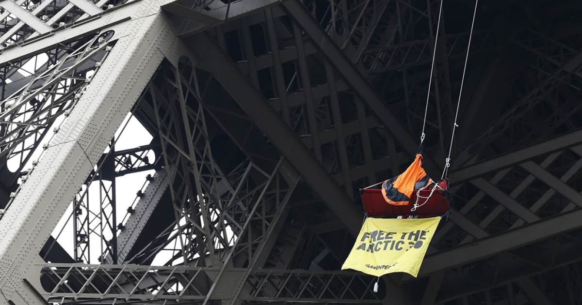 A Greenpeace activist is in a tent hanging from the Eiffel Tower on October 26, 2013 in Paris, to protest the custody of the