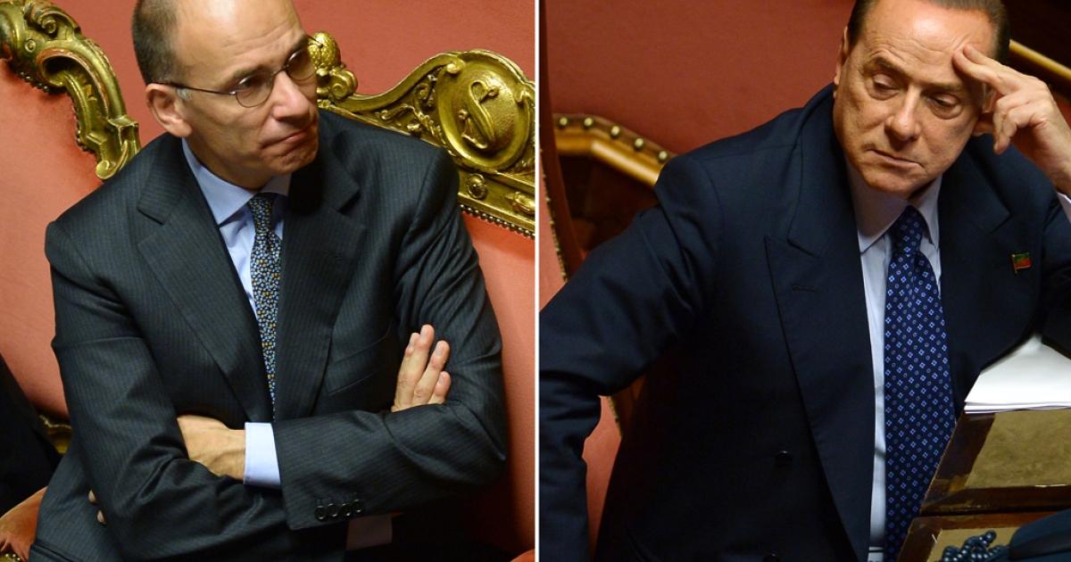 Italy's Prime Minister Enrico Letta (L) and former Prime Minister Silvio Berlusconi on October 2, 2013.</p>
