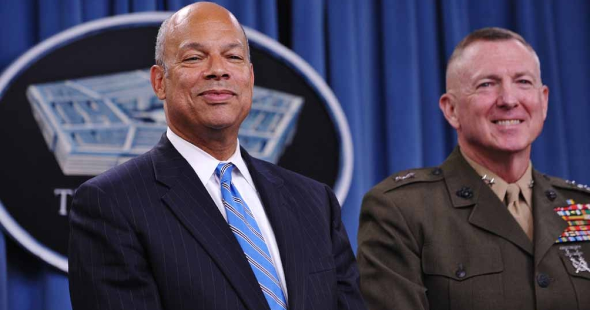 Department of Defense General Counsel Jeh Johnson (L) and Major General Steven Hummer, Chief of Staff, Repeal Implementation Team, smile during a press conference on the repeal of
