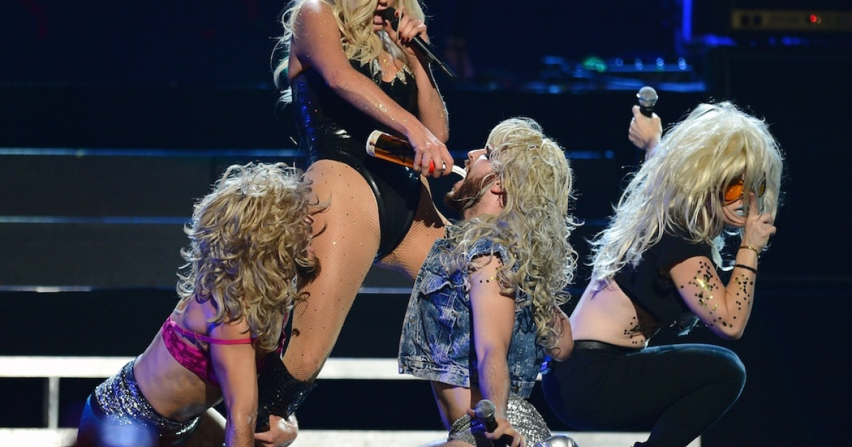 Ke$ha pours whipped cream into a dancer's mouth during a performance at the iHeartRadio Music Festival at the MGM Grand Garden Arena on Sept. 21, 2013 in Las Vegas, Nevada.</p>