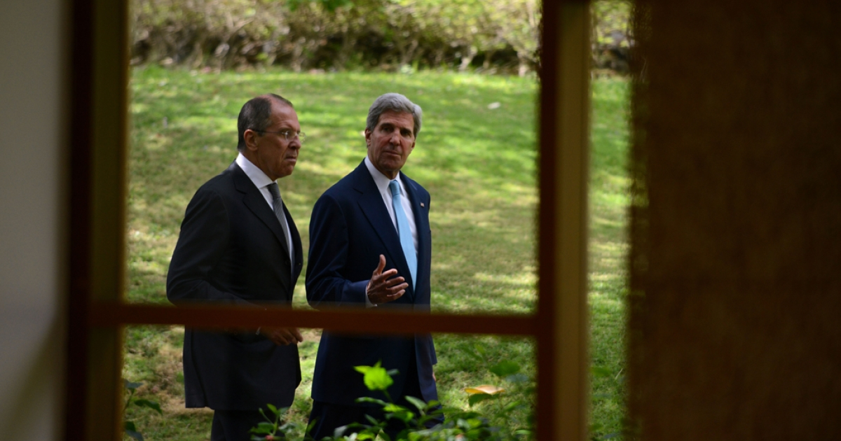 US Secretary of State John Kerry (R) walks with Russian Foreign Minister Sergei Lavrov (L) on October 7, 2013. Kerry said that Syrian leader Bashar al-Assad could take