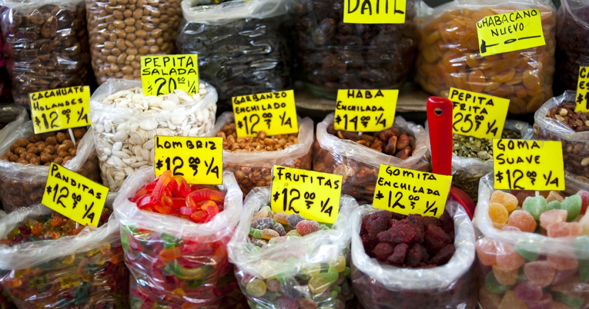 Traditional candy and dry fruit are seen for sale at a market in Mexico City. Mexico's lower house approved a tax on junk foods to fight the country's growing obesity problem.</p>