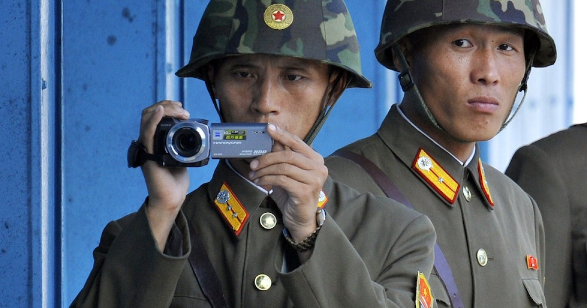 North Korean soldiers film across the demilitarized zone separating the two Koreas. Some South Korean politicians are accused of conspiring with the North.</p>