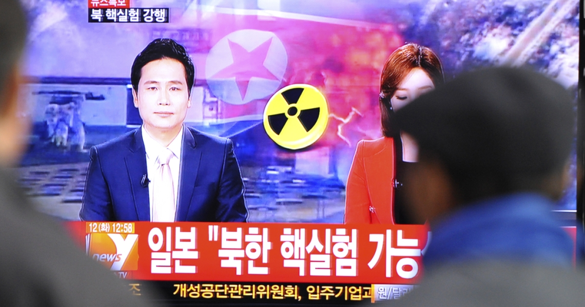 South Koreans watch TV news reports of North Korea's apparent nuclear test, Feb. 12, 2013.</p>