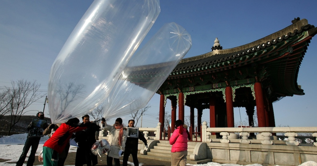 South Korean activists release balloons carrying anti-North Korea leaflets, in January 2010. Recently, the balloon campaigns have turned raunchy.</p>
