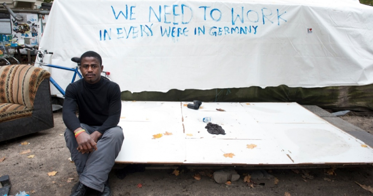 Ghanaian refugee Johnson Takyi poses at an improvised refugee camp in Berlin's Oranienplatz on Oct. 16. Takyi, who fled Libya's civil war by ship to the Italian island of Lampedusa, fears his brother was one of the hundreds of victims of this month's Lampedusa shipwreck.</p>
