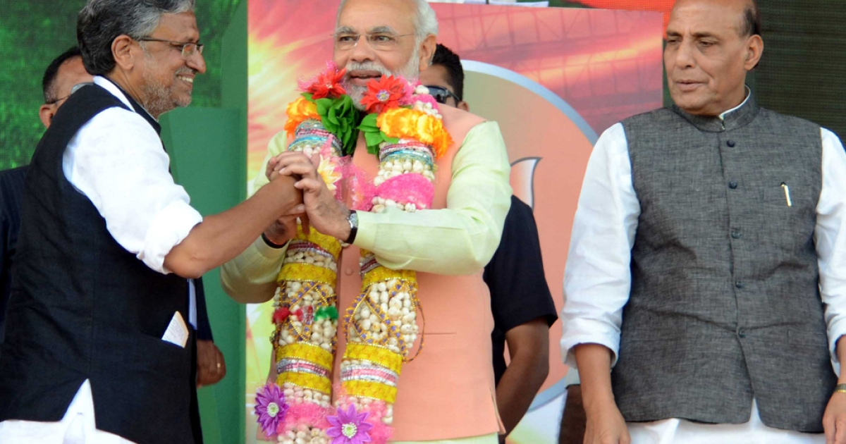 Bhartya Janta Party (BJP) prime minister candidate Narendra Modi (C) looks on during a BJP rally in Patna on October 27, 2013. A series of crude bombs exploded near the rally killing five and wounding dozens.</p>