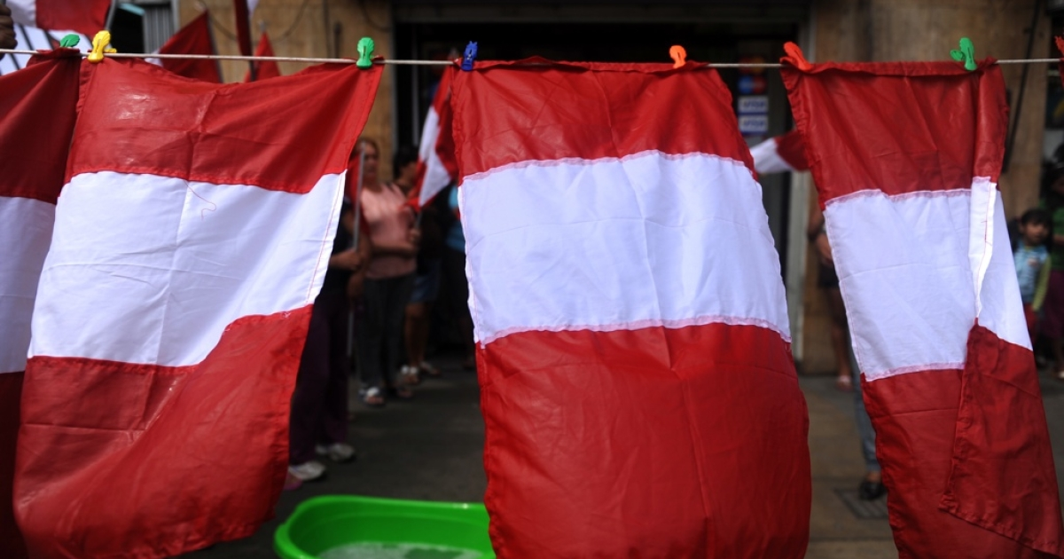 Peru's flag hangs out to dry. But can Peruvians ever scrub the country of its dirty business?</p>