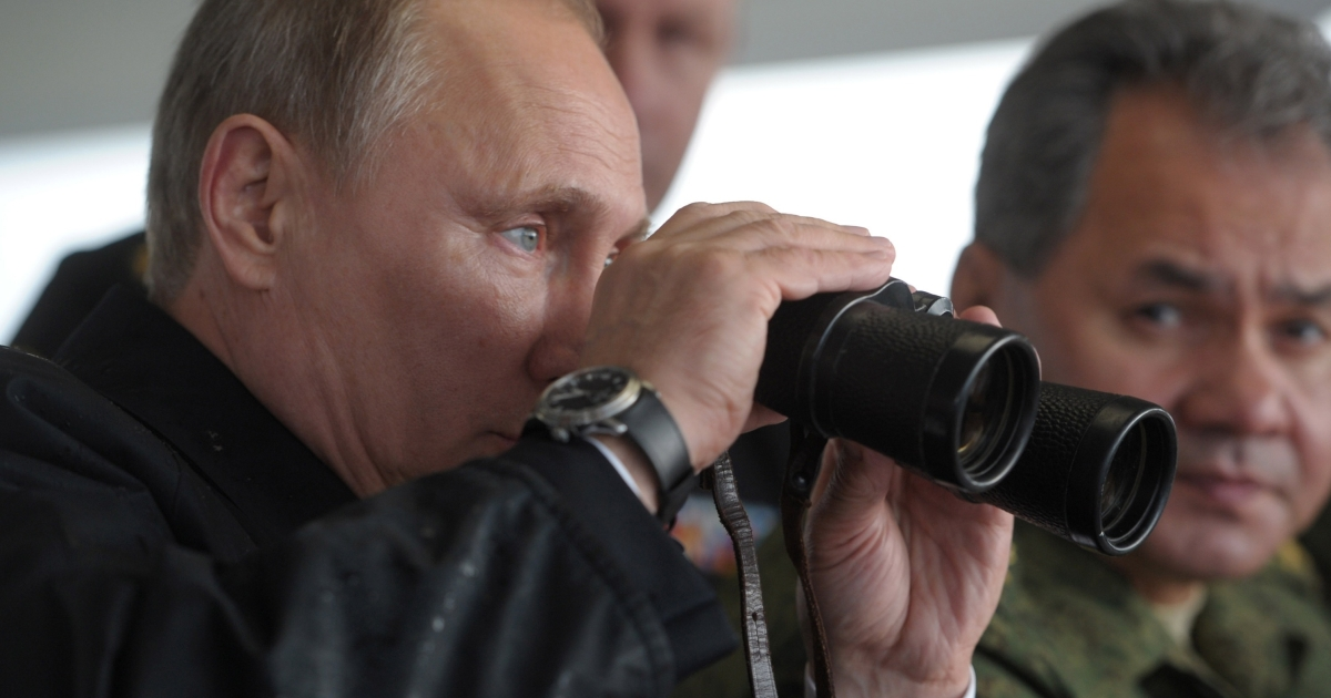 Pursuing his personal vision: Putin at joint military exercises of Russian and Belarus troops last month.</p>