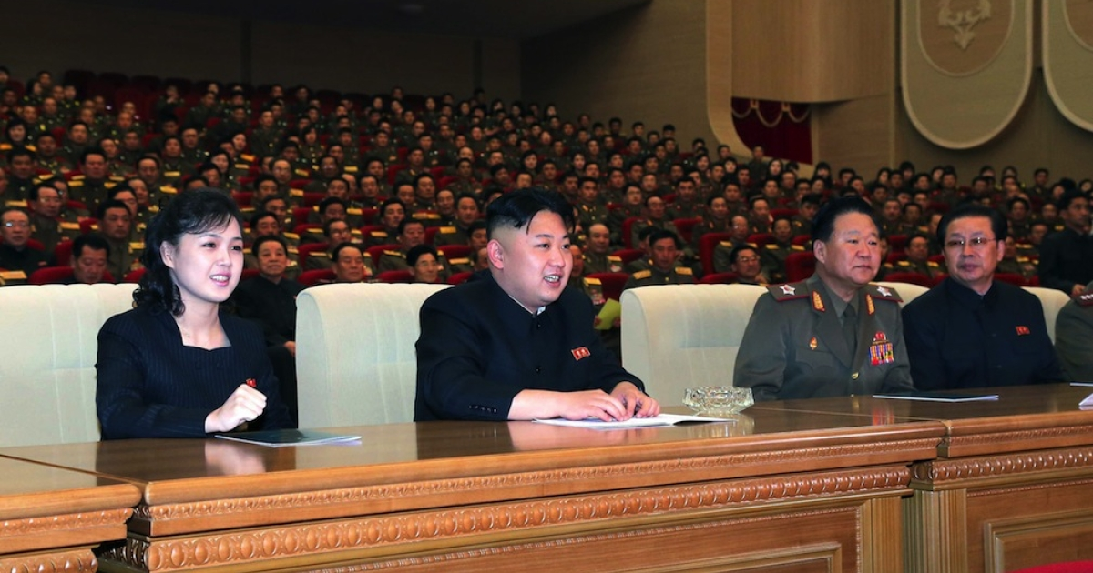 This undated picture, released by North Korea's official Korean Central News Agency (KCNA) on May 13, 2013 shows North Korean leader Kim Jong Un (C), accompanied by his wife Ri Sol Ju (L), enjoying  performance given by the Song and Dance Ensemble of the Korean People's Internal Security Forces (KPISF) in Pyongyang.</p>