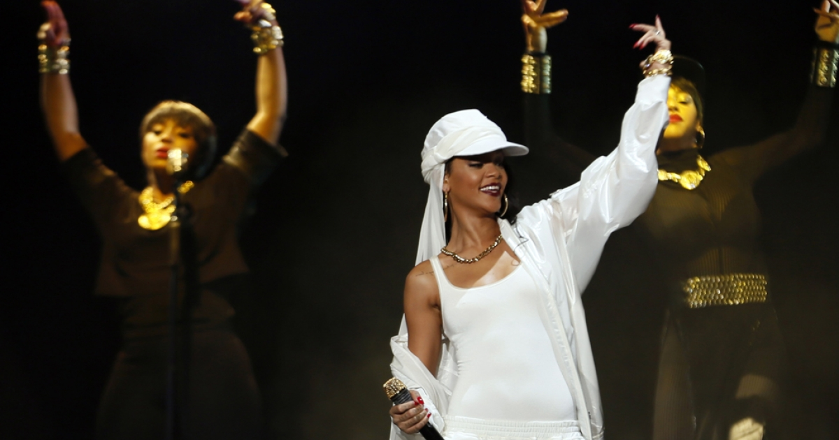 Barbadian singer Rihanna performs on stage during a concert on October 19, 2013 in Abu Dhabi.</p>
