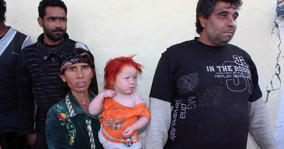 Sasha Ruseva holds one of her nine children next to her husband and Atanas Rusev in Nikolaevo, Bulgaria on Oct. 24, 2013. A DNA test confirmed the couple is the biological parents of Maria, the blonde girl found in a Greek Roma camp last week.</p>