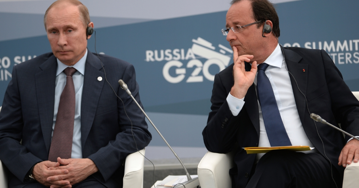 President of the French Republic Francois Hollande, (R) and President of the Russian Federation Vladimir Putin attend a meeting during the G20 summit on September 6, 2013 in St. Petersburg, Russia.</p>