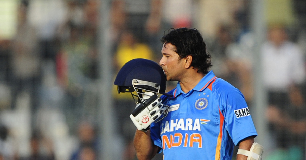 Indian batsman Sachin Tendulkar kisses his helmet after scoring his hundred century (100 runs) on March 16, 2012. He announced his retirement from cricket on October 10, 2013.</p>